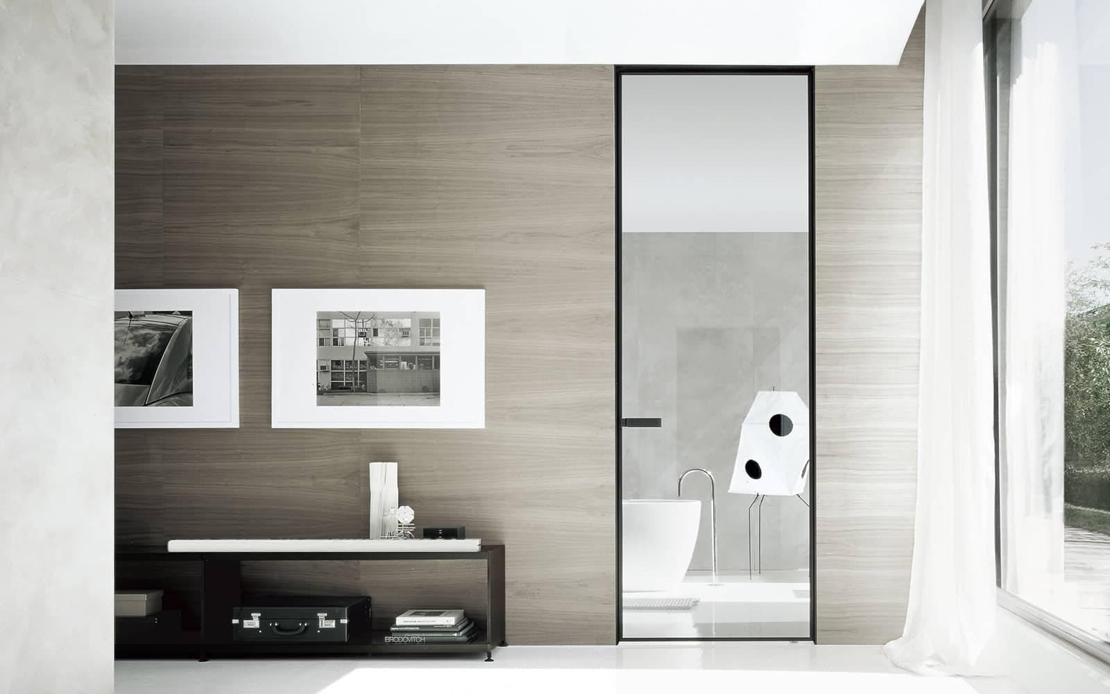 design glazen taatsdeur op maat met zwart aluminium kader