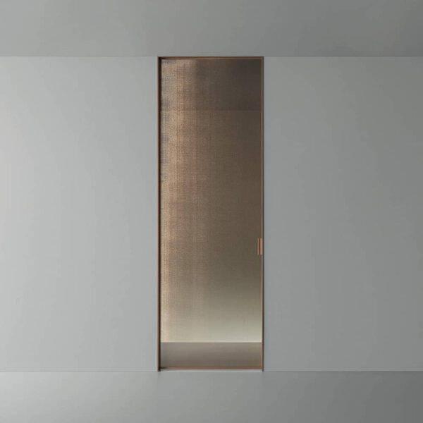design schuifdeur in de wand woonkamer met rete bronzo glas