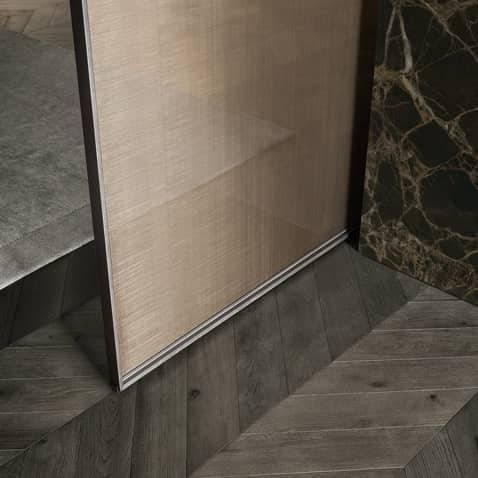 minimalistische schuifdeur met aluminium kader en rete bronzo glas