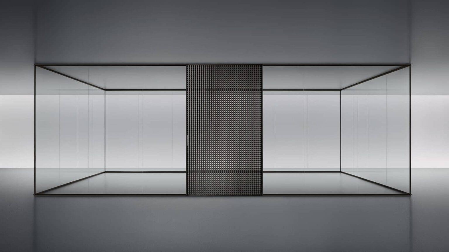 design glazen akoestische wandsystemen of scheidingswanden voor kantoren, badkamer in glas met een schuifdeur daimon van Rimadesio. Italiaans design