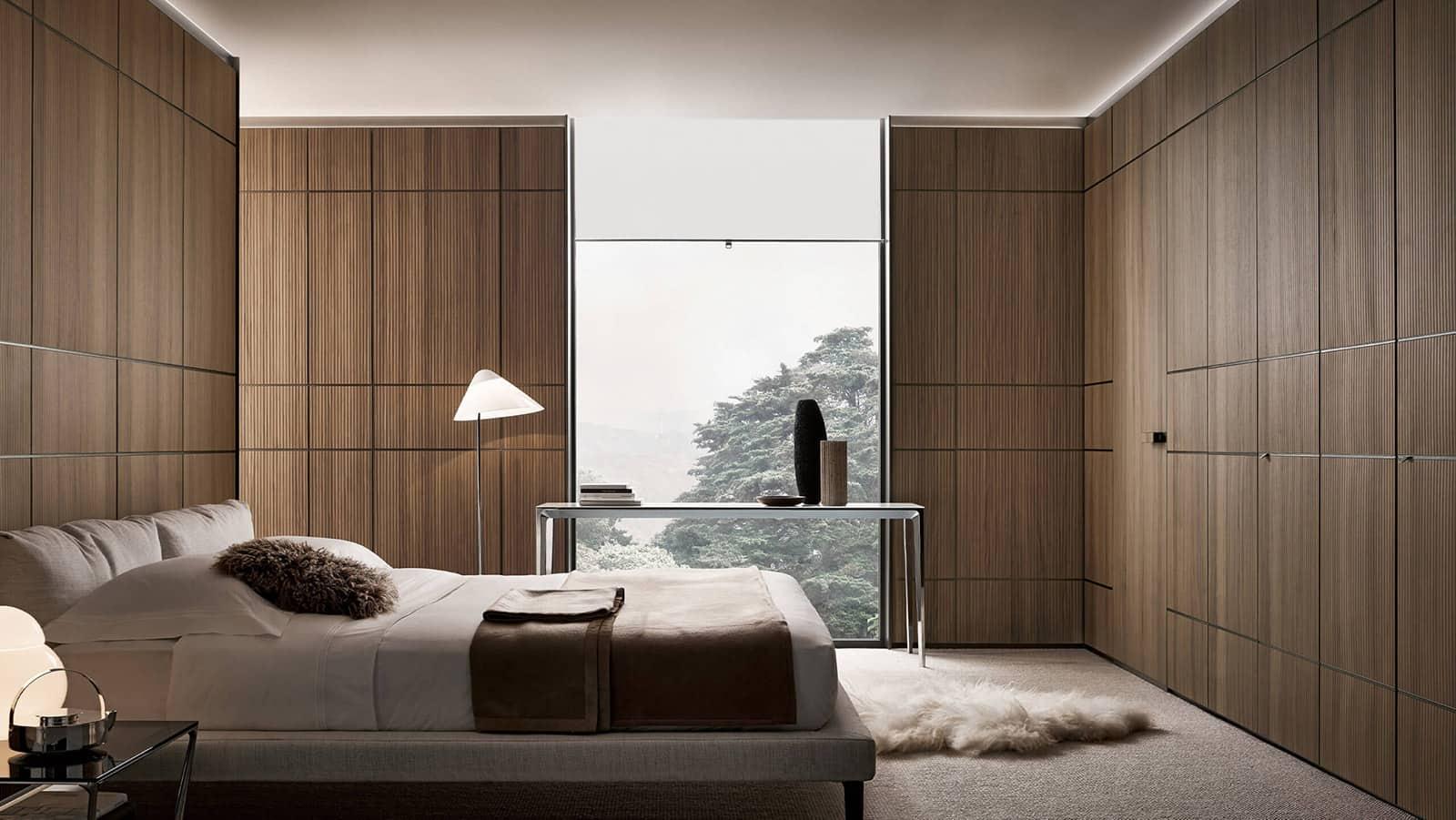 design slaapkamerontwerp met wandpanelen in notenhout en geïntegreerde rimadesio moon kozijnloze deur vlaklopend met de wand
